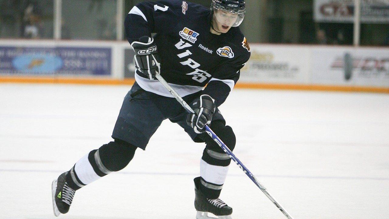 jugador de hockey hielo